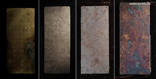 Photo taken on March 19, 2017 shows golden and silver books unearthed during an archaeological excavation at Pengshan District in Meishan City, southwest China's Sichuan Province. More than 10,000 gold and silver items that sank to the bottom of a river in Sichuan Province over 300 years ago have been recovered, archeologists said Monday. The items included a large amount of gold, silver and bronze coins and jewelry as well as iron weapons such as swords, knifes and spears. (Xinhua/Li He)