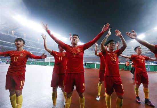 Team China greet their fans after the 2018 FIFA World Cup Russia qualification match against South Korea in Changsha, central China's Hunan province, March 23, 2017. China won 1-0. (Xinhua/Cao Can)
