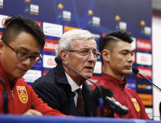 China's head coach Marcello Lippi (C) and goalkeeper Zeng Cheng attend the press conference after the 2018 FIFA World Cup Russia qualification match between China and South Korea in Changsha, central China's Hunan province, March 23, 2017. China won 1-0. (Xinhua/Ding Xu)