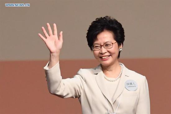 Lam Cheng Yuet-ngor waves to people after winning the election at the Hong Kong Convention and Exhibition Center in Hong Kong, south China, March 26, 2017. Lam Cheng Yuet-ngor on Sunday won the election of the fifth-term chief executive of China's Hong Kong Special Administrative Region (SAR). (Xinhua/Lui Siu Wai)