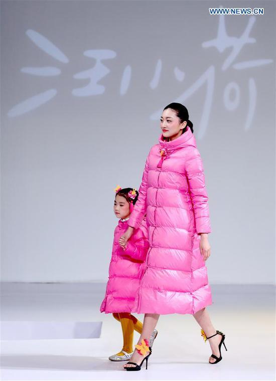 Models walk the runway at the Wangxiaohe children's collection show by Fan Yong during China Fashion Week in Beijing, capital of China, March 26, 2017. (Xinhua/Chen Jianli)