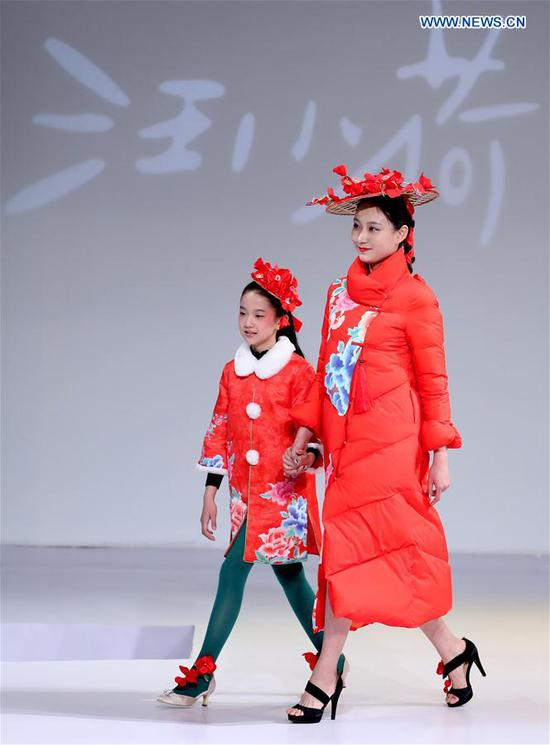 Models walk the runway at the Wangxiaohe children's collection show by Fan Yong during China Fashion Week in Beijing, capital of China, March 26, 2017. (Xinhua/Chen Jianli)