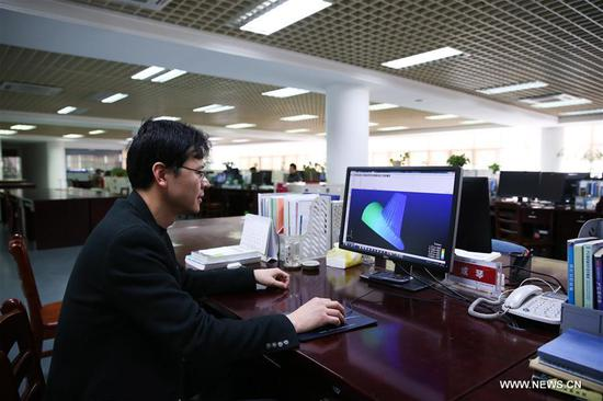 A staff member analyzes structure of captive balloon at the 38th Research Institute of China Electronics Technology Group Corporation in Hefei, capital of east China's Anhui Province, March 28, 2017. The captive balloon is an air platform carrying various devices, such as warning radar, video surveillance equipment, fog detection devices, communication relay devices and imaging equipment. The balloon is expected to play a role in precaution and detection, environmental surveillance, security and protection monitoring. (Xinhua/Cheng Tingting)