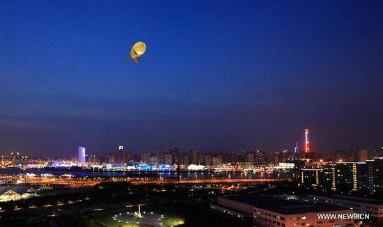 File photo taken on Sept. 7, 2010 shows a captive balloon floating in air during Shanghai World Expo in Shanghai, east China. The captive balloon is an air platform carrying various devices, such as warning radar, video surveillance equipment, fog detection devices, communication relay devices and imaging equipment. The balloon is expected to play a role in precaution and detection, environmental surveillance, security and protection monitoring. (Xinhua)