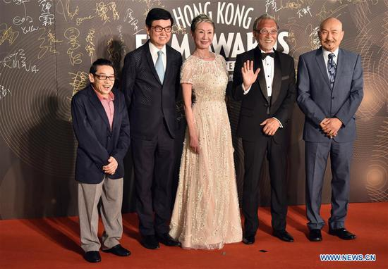 Actor and director Bak-Ming Wong(2nd L) poses on the red carpet during the 36th Hong Kong Film Awards in Hong Kong, south China, April 9, 2017. (Xinhua/Wang Xi)