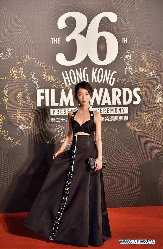 Actress Zhou Dongyu poses on the red carpet during the 36th Hong Kong Film Awards in Hong Kong, south China, April 9, 2017. (Xinhua/Wang Xi)