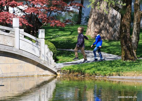 Children walk in the Zurich Chinese Garden, Switzerland, on April 12, 2017. The Zurich Chinese Garden, located right by the Zurich lake as a symbol of friendship between southwest China's Kunming and Zurich, was formally opened in 1994. (Xinhua/Xu Jinquan)
