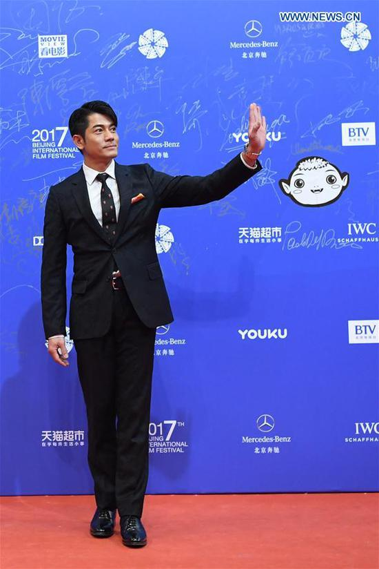 Actor Aaron Kwok poses on the red carpet during the opening ceremony of the 7th Beijing International Film Festival (BJIFF) in Beijing, capital of China, April 16, 2017. (Xinhua/Shen Hong)