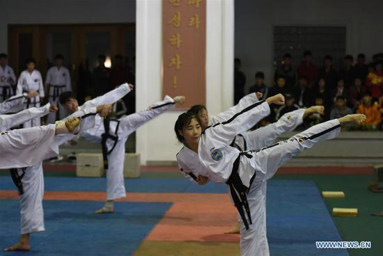 Trainees perform Taekwondo for foreign media journalists in Pyongyang, capital of the Democratic People's Republic of Korea (DPRK), on April 17, 2017. (Xinhua/Cheng Dayu)