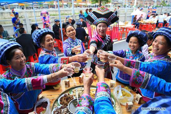 "People of Zhuang ethnic group attend a ""hundred-family banquet"" in Tianlin County, south China's Guangxi Zhuang Autonomous Region, April 17, 2017. (Xinhua/Zhang Youhao)"