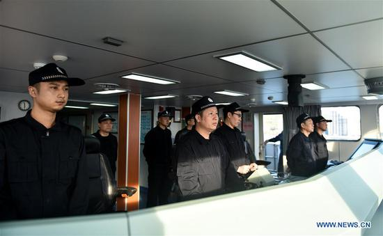Crew members prepare for the mission onboard a police vessel in Sanya, south China's Hainan Province, April 17, 2017. Two Chinese maritime police vessels on Monday left Sanya for a China-Vietnam joint fishery inspection. The inspection in the Beibu Gulf involves two police vessels from each side and will be conducted over three days, ending Thursday. Joint inspections began in 2006 as an annual event, and were increased to twice a year in 2016. (Xinhua/Mao Siqian)