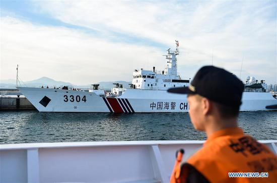 Police vessels leave Sanya, south China's Hainan Province, April 17, 2017. Two Chinese maritime police vessels on Monday left Sanya for a China-Vietnam joint fishery inspection. The inspection in the Beibu Gulf involves two police vessels from each side and will be conducted over three days, ending Thursday. Joint inspections began in 2006 as an annual event, and were increased to twice a year in 2016. (Xinhua/Mao Siqian)
