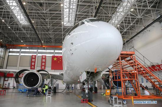 Photo taken on April 11, 2017 shows C919, the first large passenger aircraft designed and built by China, in a hangar of Shanghai-based Commercial Aircraft Corp. of China (COMAC) in Shanghai, east China. The aircraft was given the go-ahead to begin a series of high-speed taxiing tests, the last step before its maiden flight. (Xinhua/Ding Ting)