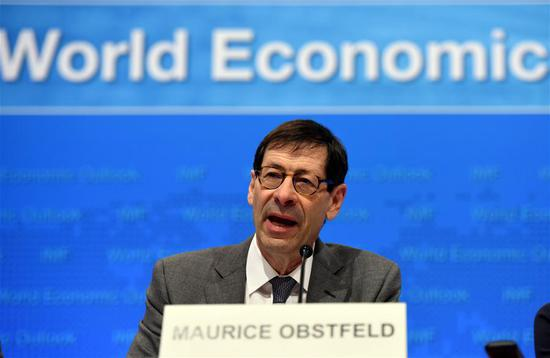 Maurice Obstfeld, chief economist at the International Monetary Fund (IMF), attends a press briefing at the IMF headquarters in Washington D.C., the United States, on April 18, 2017. The International Monetary Fund (IMF) on Tuesday raised its forecast for global economic growth in 2017, saying buoyant financial markets and a long-awaited cyclical recovery in manufacturing and trade supported the improved outlook. (Xinhua/Yin Bogu)