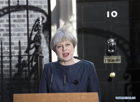 British Prime Minister Theresa May speaks to media outside 10 Downing Street as she calls a snap general election in London, Britain, on April 18, 2017. British Prime Minister Theresa May called a snap general election on June 8 in what was a shock and unexpected announcement from outside 10 Downing Street. (Xinhua)