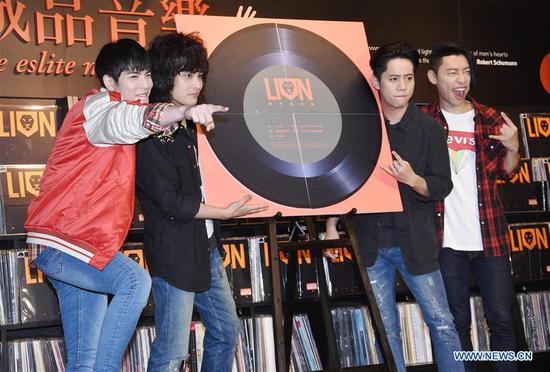 Singer Jam Hsiao (1st L) and members of the Lion attend a press conference of their new album