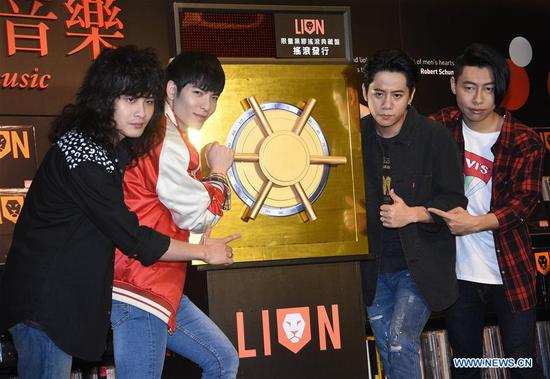 Singer Jam Hsiao (2nd L) and members of the Lion attend a press conference of their new album