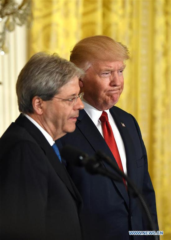 """U.S. President Donald Trump (R) attends a joint press conference with Italian Prime Minister Paolo Gentiloni at the White House in Washington D.C., the United States, on April 20, 2017. Despite his administration's certification of Iran's compliance with the 2015 nuclear deal, U.S. President Donald Trump on Thursday accused Iran of """"not living up to the spirit"""" of the nuclear deal. (Xinhua/Yin Bogu)"""