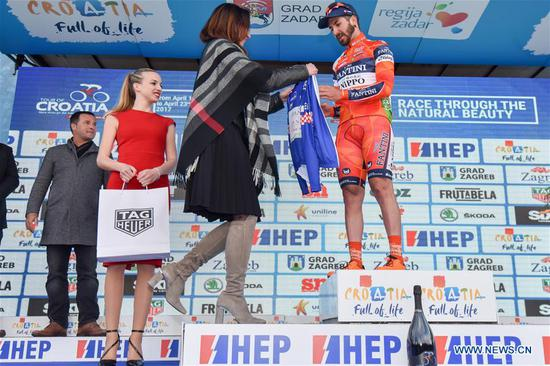 Grosu Eduard Michael from Romania wins the overall race leader at the third stage of international cycling race tour of Croatia 2017 in Zadar, south Croatia, April 20, 2017. The third stage of the race, a total distance of 237km, started from Imotski and finished in Zadar. (Xinhua/Dino Stanin)