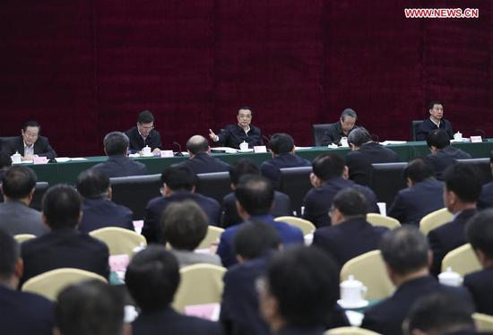 Chinese Premier Li Keqiang (C, rear) presides over a meeting on state-owned enterprises under direct administration of central government as he inspects China Aerospace Science and Industry Corporation (CASIC) in Beijing, capital of China, April 27, 2017. (Xinhua/Xie Huanchi)