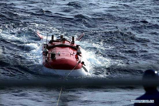 Jiaolong, China's manned submersible, returns after conducting its dive mission in the South China Sea, south China, April 29, 2017. Jiaolong conducted its third dive Saturday in the South China Sea during the second stage of China's 38th ocean scientific expedition. Spending nine hours and thirty-five minutes in water, the maximum depth of the Jiaolong's work this time was 2,930 meters below sea level. (Xinhua/Liu Shiping)