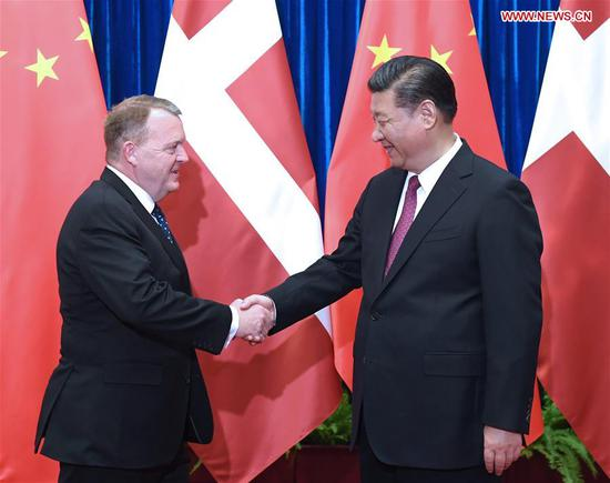 Chinese President Xi Jinping meets with Danish Prime Minister Lars Loekke Rasmussen at the Great Hall of the People in Beijing, capital of China, May 4, 2017. (Xinhua/Rao Aimin)