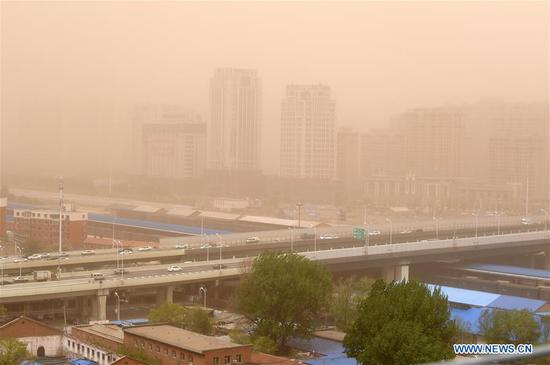 Buildings are shrouded by sandstorm in Changchun, capital of northeast China's Jilin Province, May 6, 2017. A sandstorm and strong wind hit Changchun on Saturday. (Xinhua/Lin Hong)