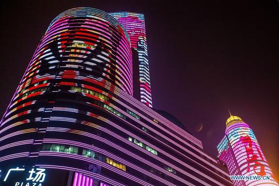 Photo taken on May 6, 2017 shows a light show in the Xinjiekou area of Nanjing, capital of east China's Jiangsu Province, to greet the upcoming 8th China Peking Opera art festival. The art festival will be held in Nanjing from May 11 to 29. (Xinhua/Su Yang)