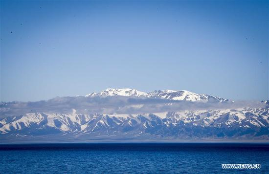 Photo taken on May 8, 2017 shows the Sayram Lake and snow mountain in northwest China's Xinjiang Uygur Autonomous Region. The Sayram Lake is a very beautiful lake surrounded by grasslands and the Tianshan Mountains in Xinjiang. (Xinhua/Zhao Ge)