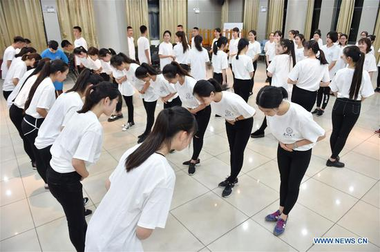 Volunteers for the 2017 BRICS Summit from Xiamen University take part in an etiquette training in Xiamen, southeast China's Fujian Province, May 10, 2017. The 2017 BRICS Summit will be held in September in Xiamen. (Xinhua/Song Weiwei)