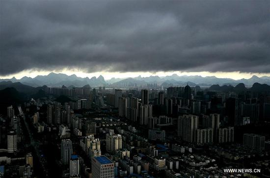 Photo taken on May 15, 2017 shows the city of Liuzhou shrouded by clouds in south China's Guangxi Zhuang Autonomous Region. (Xinhua/Li Hanchi)