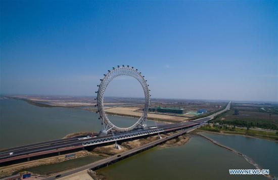 Aerial photo taken on May 17, 2017 shows a centerless ferris wheel located in Weifang City, east China's Shandong Province. The ferris wheel, whose diameter is 125 meters, has a height of 145 meters. It is built according to the designing concept of kite and has 36 sight-seeing cabins. (Xinhua/Sun Shubao)
