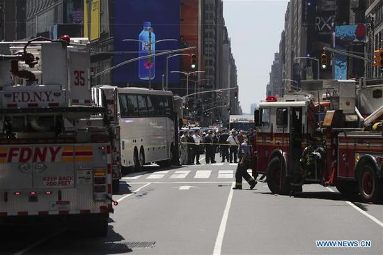 Emergency workers gather on the scene of a car crash incident at Times Square in New York City, the United States, on May 18, 2017. One young woman was killed and 22 people injured after a car plowed into pedestrians in Times Square on Thursday, officials said. (Xinhua/Wang Ying)