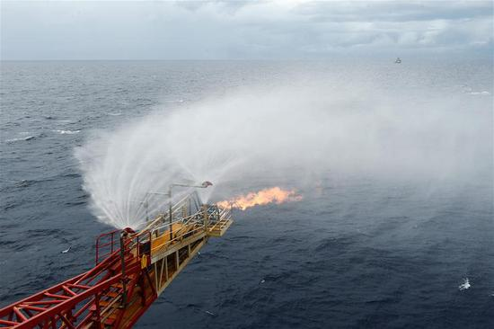 Photo taken on May 16, 2017 shows the flames spouting from the trial mining site in the Shenhu area of the South China Sea. China has succeeded in collecting samples of combustible ice in the South China Sea, a major breakthrough that may lead to a global energy revolution, Minister of Land and Resources Jiang Daming said Thursday. (Xinhua/Liang Xu)