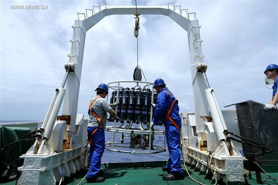 Scientists test the temperature, salinity and depth of the seawater as they prepare for the dive of the Jiaolong, China's manned submersible, on its mother ship Xiangyanghong 09, May 22, 2017. The ship arrived at the Mariana area Monday and started testing temperature, salinity and depth for Tuesday's dive in the Mariana Trench, the first of the expedition's third stage. (Xinhua/Liu Shiping)