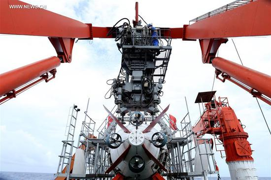 Technicians prepare for the Jiaolong, China's manned submersible, on its mother ship Xiangyanghong 09, May 22, 2017. The ship arrived at the Mariana area Monday and started testing temperature, salinity and depth for Tuesday's dive in the Mariana Trench, the first of the expedition's third stage. (Xinhua/Liu Shiping)