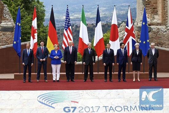 Leaders of the Group of Seven (G7) industrialized nations, plus the EU, pose for a photo in the ancient Greek theatre of Taormina, Italy, on May 26, 2017. (Xinhua/Jin Yu)