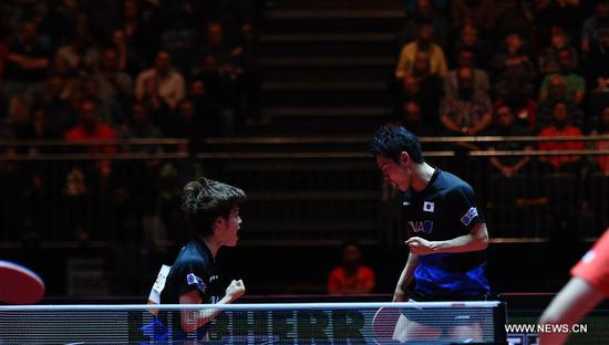 Morizono Masataka(L)/Oshima Yuya of Japan celebrate during the men's doubles final match against Xu Xin/Fan Zhendong of China at the 2017 World Table Tennis Championships in Dusseldorf, Germany, June 4, 2017. (Xinhua/Tao Xiyi)