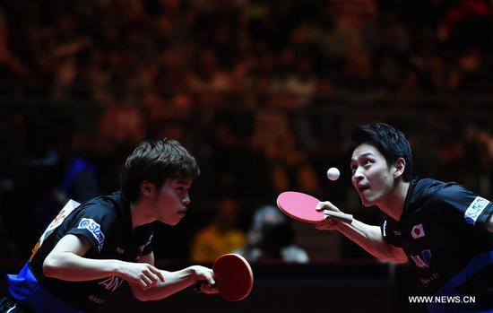 Morizono Masataka(L)/Oshima Yuya of Japan compete during the men's doubles final match against Xu Xin/Fan Zhendong of China at the 2017 World Table Tennis Championships in Dusseldorf, Germany, June 4, 2017. (Xinhua/Tao Xiyi)