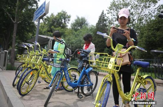 Golden bikes are seen parked on a street in Beijing on June 8, 2017.