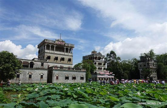 People visit the scenic spot of Diaolou in Zili Village, Kaiping City of south China's Guangdong Province, June 10, 2017. The Diaolou (watchtower house) of Kaiping was inscribed on World Heritage List in 2007. (Xinhua/Xu Jianmei)