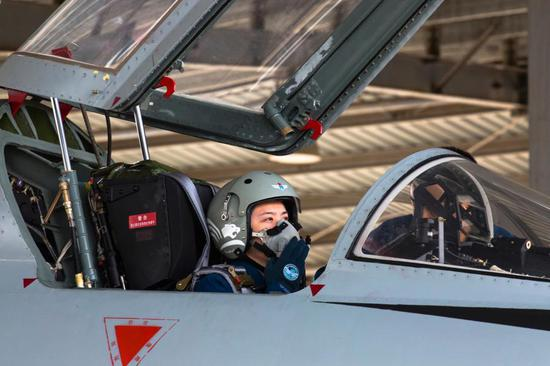 A female pilot sitting in the cockpit of her JH-7 fighter bomber performs preflight check prior to a flight training exercise in east China's Shandong Province. She is assigned to a brigade of the air force under the PLA Northern Theater Command. (Photo/eng.chinamil.com.cn)