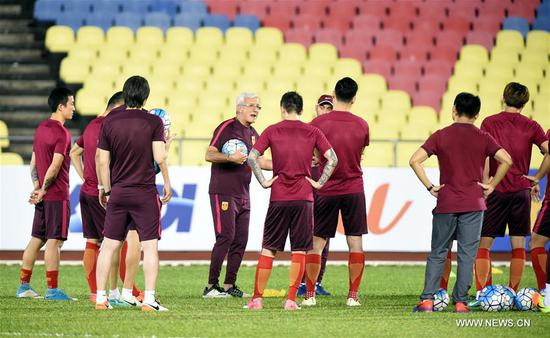 China's head coach Marcello Lippi (4th L) gestures during the training session before the 2018 FIFA World Cup Russia qualification match between China and Syria in Malacca, Malaysia, June 12, 2017.(Xinhua/Lo Ping Fai)