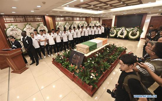 Soccer players of Beijing Enterprises attend the funeral of Cheick Tiote at the Babaoshan funeral center in Beijing, capital of China, June 13, 2017. Cheick Tiote died in hospital after fainting at the Beijing Enterprises club's training ground on June 5, 2017. (Xinhua/Xia Yifang)