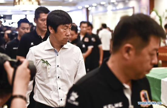 Gao Hongbo (C), head coach of Beijing Enterprises attends the funeral of Cheick Tiote at the Babaoshan funeral center in Beijing, capital of China, June 13, 2017. Cheick Tiote died in hospital after fainting at the Beijing Enterprises club's training ground on June 5, 2017. (Xinhua/Xia Yifang)