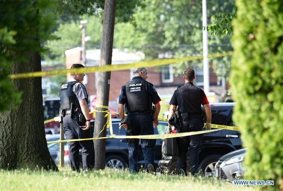 Policemen work at the site of the gunshot at Eugene Simpson Stadium Park in Alexandria, Virginia state, the United States, on June 14, 2017. The gunman who opened fire Wednesday morning at a U.S. congressional baseball practice field has been identified as James T. Hodgkinson, a white male in his 60s. (Xinhua/Yin Bogu)