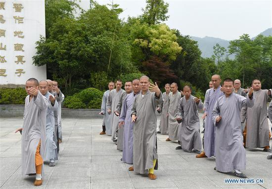 Monks practice Taiji, a traditional form of Chinese martial arts, at Mount Jiuhua Buddha College, east China's Anhui Province, June 15, 2017. Mount Jiuhua Buddha College was founded in 1990. (Xinhua/Guo Chen)