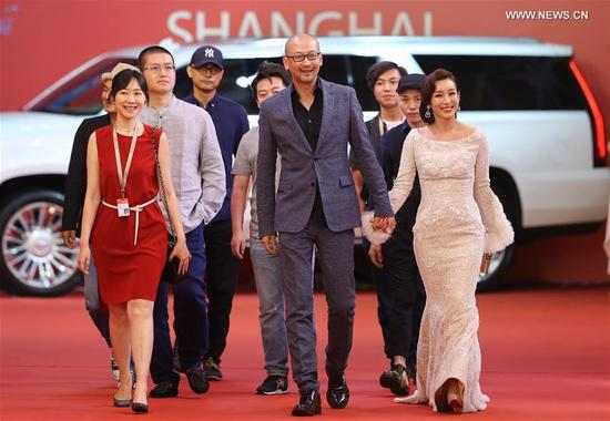 Director Guan Hu (C) and actress Qin Hailu (1st R) attend the 20th Shanghai International Film Festival in Shanghai, east China, June 17, 2017. The 20th Shanghai International Film Festival kicked off here Saturday. (Xinhua/Ding Ting)