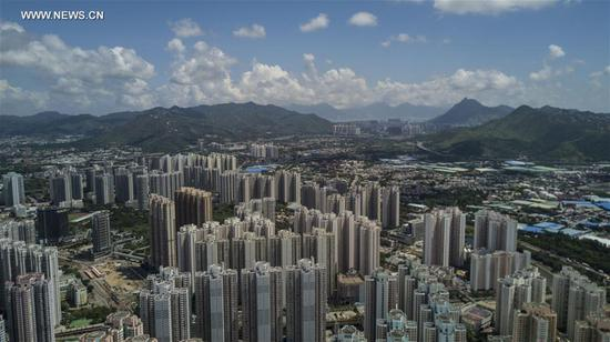 Buildings are seen in Tin Shui Wai in Hong Kong, south China, June 6, 2017. Over the past 20 years, Tin Shui Wai has witnessed the dramatic development of Hong Kong. The year 2017 marks the 20th anniversary of Hong Kong's return to the motherland. (Xinhua/Lui Siu Wai)