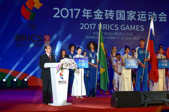 Gou Zhongwen, director of China's General Administration of Sport, recites a congratulatory letter sent from Chinese President Xi Jinping, during the opening of the BRICS Games at the Guangzhou Baiyun International Convention Center in Guangzhou of south China's Guangdong Province, June 17, 2017. The first-ever BRICS Games raised its curtain here on Saturday evening. (Xinhua/Liu Dawei)